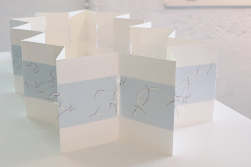 Untitled (concertina map book), installation view, cotton-rag paper, cotton thread, drafting film, graph paper, dimensions variable open, 18cm x 12cm closed, 2012