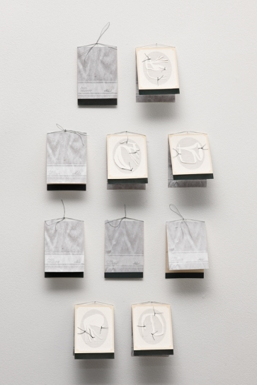 Single use display cards, installation view, digital print on archival matte paper, cotton-rag paper, linen thread, each 19.3cm x 6.8cm open, 10cm x 6.8cm closed, 2010