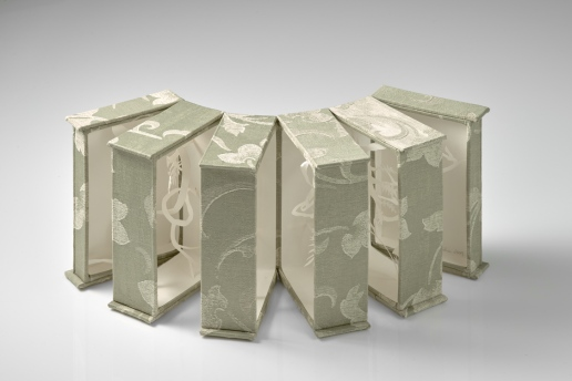 Sliced box view, upholstery fabric, box board, cotton-rag paper, felt, 16cm x 31.5cm x up to 34cm open, 2009